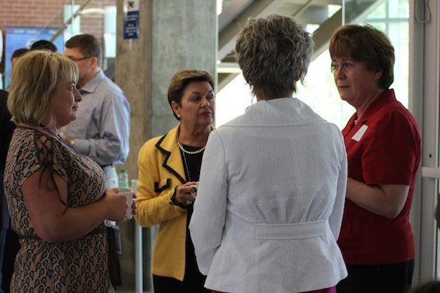Dr. Jackalina VanKampen chats with other delegates.